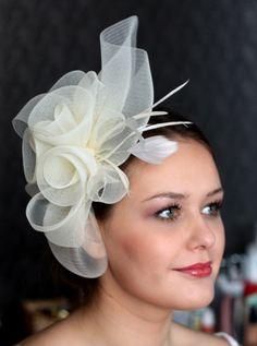 Wedding Hat, Couture Bridal Hat. Ivory Bridal Hat, Wedding Birdcage Veil, Wedding Headpiece, Ivory Wedding Fascinator by klaxonek on Etsy https://www.etsy.com/listing/123438159/wedding-hat-couture-bridal-hat-ivory