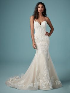 In a word, wowza! This lace fit-and-flare wedding dress is designed to fit, flatter, and charm from every angle.