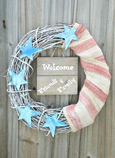 Welcome your guests at the front door with a fun patriotic wreath. Easy DIY for Labor Day, Memorial Day and Fourth of July. www.H2OBungalow.com #patriotic #redwhiteandblue