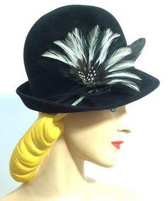 Tall Crown Black Velvet Bowler Style Tilt Hat w/ Feathers, circa 1940s, via Dorothea's Closet Vintage.