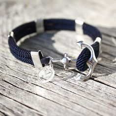"""Enjoy this classic, nautical """"New Haven"""" sailor's bracelet with a true maritime look and feel. An original Maris Sal design now available in pure sterling silver for the selective jewelry connoisseur. Made of Navy Blue colored, soft and comfortable, nylon cord with a solid sterling silver anchor and accents, this bracelet is a pleasure to wear for any sea loving man or woman.  marissal.se"""