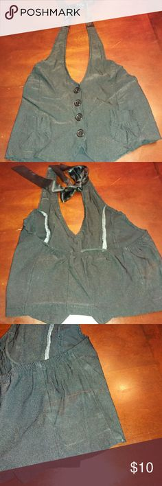 Halter vest This vest is so cute! Halter vest ...button down front....two breast pockets...back out...satin tie at neck. Has a lot of stretch.  Can be worn with or without a blouse.  Flaw- slight fade shown in last pic. The use of black dye may resolve this. Tops