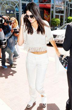 Kendall Jenner wearing: Creatures of Comfort Fringe Trim Sweater and Miu Miu Metallic-Toe Sport Sneakers