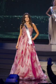 Saly Greige, Miss Lebanon 2014 competes on stage in her evening gown during the Miss Universe Preliminary Show in Miami, Florida on January 21, 2015.