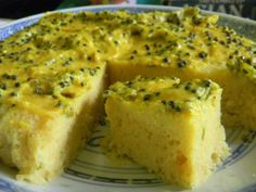 Khaman Dhokla - steamed Indian besan cake with coconut, mustard seed, chilli, tumeric, lemony topping. Made this delicious brunch delight in recent experiments with the huge diversity of ingredient combos found in Indian foods.