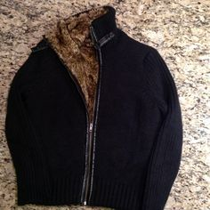 AMAZING large Orvis fur-lined sweater jacket You probably won't see many people or find this particular sweater on PM.  IT IS GORGEOUS!  It is a large Orvis fur-lined sweater jacket.  The shell is 50% wool and 50% acrylic.  The lining is 100% modacrylic.  NO TRADES. Orvis Sweaters