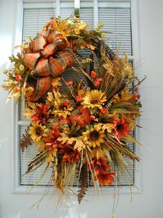 Fall floral door wreath with pumpkins and cattails