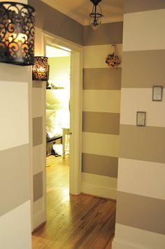 Painted striped hall way (I love the large stripes in such a small space)