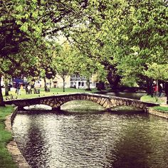 "See 411 photos from 3372 visitors about english village, scones, and tea. ""The archetypical traditional English village. Wade through the river, feed. Bourton On The Water, English Village, Holiday Destinations, Great Britain, The Rock, Bridges, Beautiful Places, England, River"