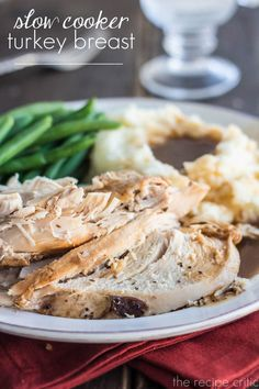Slow Cooker Turkey Breast at http://therecipecritic.com  The most delicious moist and tender turkey you will make!  It slow cooks all day in amazing juices and is absolute perfection!