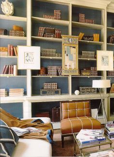 Interior contract color, artwork installed on the framework ...love this bookshelf!