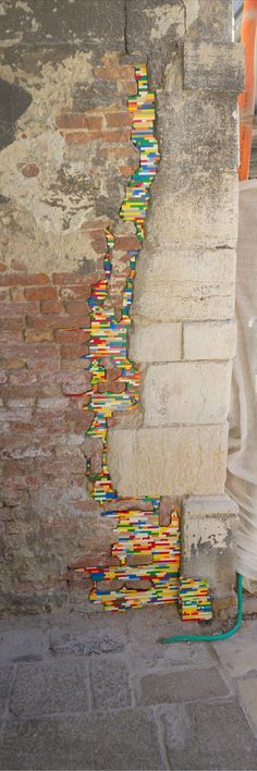 Jan Vormann, 26, is a German artist who has spent the last three years travelling the world fixing crumbling walls and monuments using Lego. Vorman took his project from its humble beginnings at an art fair in Rome and brightened up thousands of people's days with his brightly colored plastic Lego bricks.