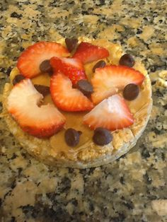 1 Quaker caramel corn rice cake, 1 tablespoon of peanut butter, 1 strawberry, and a couple of chocolate chips! Great snack to have, and delicious too!