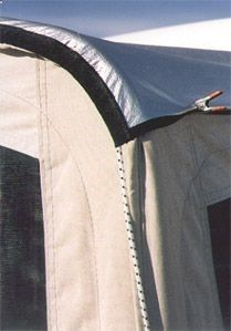 Solar bunk end covers. Silver side up for summer, silver side down for winter. Can produce a 20 deg.F difference in temperature. Use sporstsman space blankets from Cabelas or Walmart.