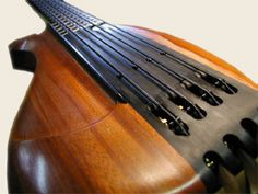 Xavier Padilla custom bass by Little Guitar Works... like the pickup pole pieces poking through the body