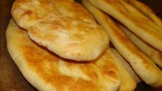 Yummy Indian naan bread .. Goes great with curries etc .. very easy to make since the bread machine does all the work! Try adding spices, or use whole wheat flour instead of white ..