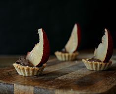Miniature Whole Grain Tarts Filled with Chocolate and topped with Caramelized Plums