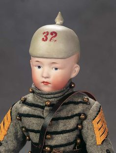 """14"""" (36cm) Extremely Rare German Bisque Pouty with Sculpted Pickelhaube (spiked helmet) by Gebruder Heubach.  Marks: 9122 (9129?) Heubach (in square) Germany. Comments: Gebruder Heubach,circa 1915. Value Points: very rare character model by Heubach,the sad-faced soldier has the classic sculpted Prussian spiked helmet; few other examples are known to exist. (Sold $US3000)"""