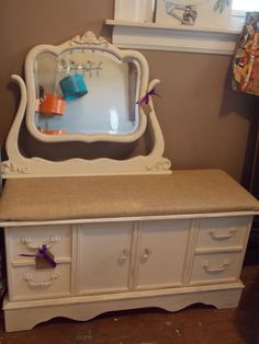 Cedar chest in a creamy white with a burlap cushion.  Mirror is separate