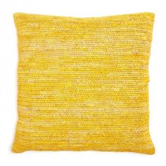 Sil'ouette Yellow Crochet Raffia Pillow  Hand crocheted from natural raffia and hued with beautiful vegetable dyes, the Sil'ouette Raffia Pillow is crafted by indigenous women in Madagascar. The production of these pillows ensures fair-trade employment and supports children.