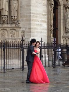 red wedding dress in front of Notre Dame!