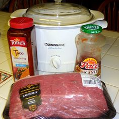 Shredded roast tacos in a Crockpot. This recipe is great.  Makes allot.  Good for a party or to use as freezer meals.