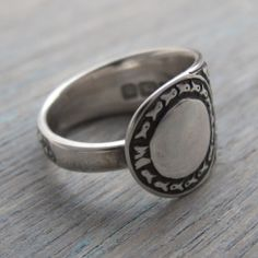 I made this lovely ring from an antique sterling silver teaspoon. It has a lovely design that is enhanced by the antique patina applied.