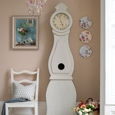 Update the clock, leave it where it is with the free parson's chair and some cute wall decor - maybe I'll take the clock!!