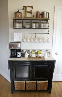 home coffee station. It would be so easy to hang a towel rack and use S-hooks from the hardware store to hang coffee mugs over any table.