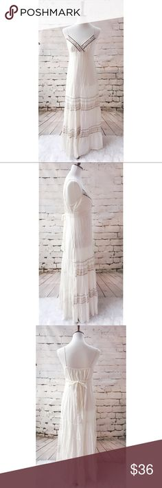 NWT Promod White Spaghetti Strap Maxi Dress NWT Promod White Spaghetti Strap Maxi Dress With Adjustable Straps.  Beautiful embroidered decoration.  One small stain on the back otherwise in perfect condition. Promod Dresses Maxi