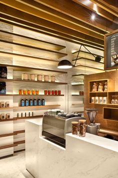 white brick, Marble Counter, Inset Espresso Machine, Wood Shelving, Decoration/Function Harmony