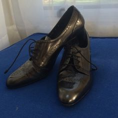 Stuart weitzman heels Metallic black very original looking heels. These lace up and have subtle detailing throughout. In fantastic condition. Comes with box, make an offer! Stuart Weitzman Shoes Heels