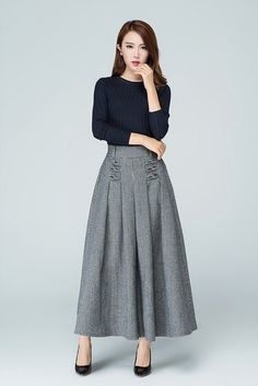 Wool plaid skirt, it will be popular in the winter DETAIL * wool blend,polyester lining * two side pockets * soft pleats front and back * special detail in the front * full length * winter skirt *elastic waist SIZE GUIDE Available in women's US sizes 2 to 18, as well as custom size and