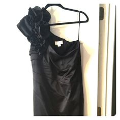 Jessica Simpson Black Satin Formal Cocktail Dress Jessica Simpson Black Satin Formal Cocktail Dress. One shoulder dress in black satin. Perfect as a formal dress or cocktail dress. Knee length. Hidden side zipper. Worn once. No flaws or signs of wear. Excellent condition. Jessica Simpson Dresses One Shoulder