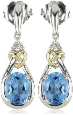 Oval-shaped blue topaz stones add color to this elegant drop earring design. Two 14k gold love knot accents stand out against the sterling silver backdrop.