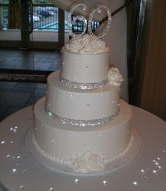 Sparkles in Elegance Buttercream Wedding Cake  Take away the 60 and put a rhinestone monogram 'H' and it's PERFECT! <3