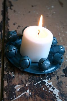 Candle holders made from bells and recycled can lids