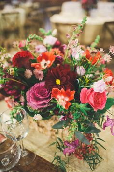 lush winter centerpiece - photo by Connection Photography http://ruffledblog.com/romantic-garden-wedding-in-north-carolina #centerpieces #flowers #weddingideas