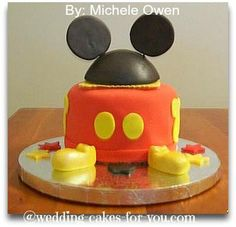 Mickey Mouse Birthday Cake: This Mickey Mouse birthday cake was for a one year old girl's birthday.   Here is how I made this fun Mickey Mouse Cake  The hat was constructed by cutting
