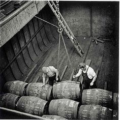 Men loading whiskey barrels by ballasttrust