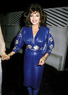 1986 September  Joan attended Spago in Hollywood wearing this cobalt blue leather dress.