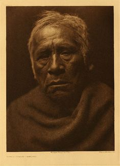 """Captain Charley - Maricopa, 1907. Photogravure. Curtis Caption: """"This portrait shows clearly the strongly Yuman cast of features retained by this branch of the stock."""""""