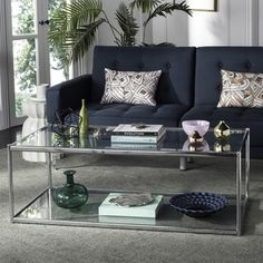 Shop for Safavieh Zola Glass Chrome Coffee Table. Get free shipping at Overstock.com - Your Online Furniture Outlet Store! Get 5% in rewards with Club O! - 21131466