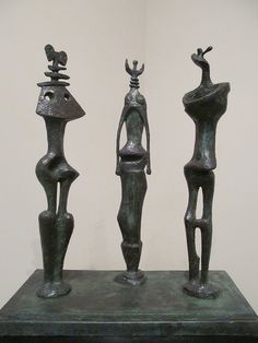 Henry Moore. Three Standing Figures, 1953. Bronze
