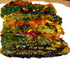 Impossibly delicious to some of us, the mighty karela, also known as bitter gourd or bitter melon, is definitely an acquired taste. But here's a surefire way to fall in love with this spiky, rather Indian Food Recipes, Asian Recipes, Vegetarian Recipes, Healthy Recipes, Ethnic Recipes, Paleo Food, Veg Recipes, Healthy Cooking, Healthy Eats