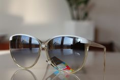 Translucent Tortoise frame, decorated with a White stripe on Forehead, with White Arms and with Medium Dark lenses from Polaroid's Vintage Sunglasses