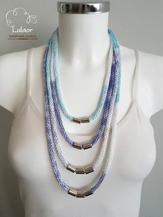 Handmade knitted necklace. Made of a blue, purple and white cotton yarn, acrylic silver tubes and a silver color clasp. This beautiful necklace will upgrade any outfit day or night. Perfect for the spring and summer time. Length approx: 38cm Please feel free to contact me for any question.