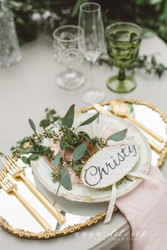 Our gold-rimmed mirrors reflect beautiful light beneath mix-matched china and gold flatware.  The vintage glassware add additional charm to this stunning wedding tabletop.