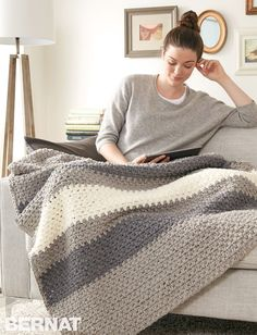 Hibernate Made Easy Hibernate yourself with a snuggly blanket to tuck yourself into the sofa. Using Bernat Blanket Yarn that