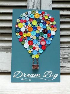 This wooden decoration, A hot air balloon made with buttons and partially string art is placed on a pink painted wooden piece (0,20x0,30m). the quote, Dream big Little One is hand painted and with swarovski rhinestones. This can be a perfect decoration for a baby girls room. I can custom make the sign for a baby boy too.  Any of the signs take 4-5 days to make. After that they will be shipped immediately.  -Any color or size available upon request.